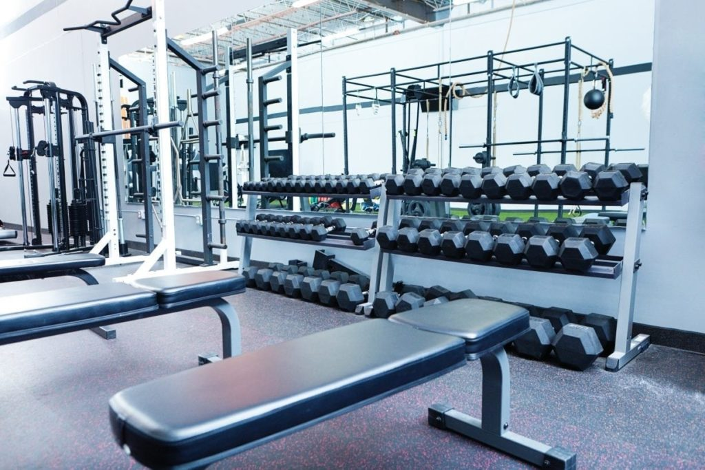 Indoor Weight Lifting Training Equipment in Interior Gymnasium Health Club